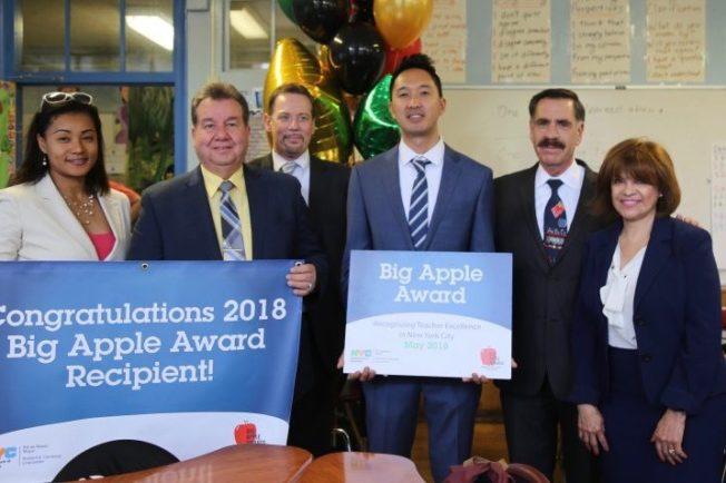 Chancellor Carranza poses with members of the DOE and Big Apple Award winner Ryuma Tanaka, Hunter College Alum.