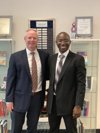 New York State Teacher of the Year Alhassan Susso posing with Dean Michael Middleton