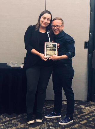 Lindsay Orcutt receiving award from Jonathan Hopper